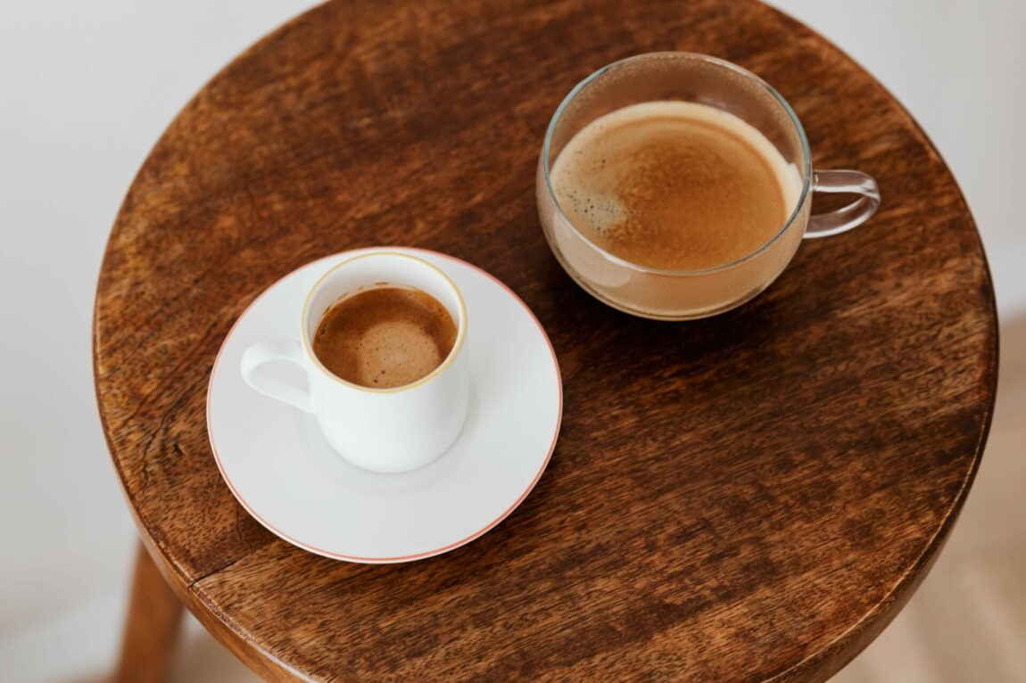 Round table with two coffee cups on it